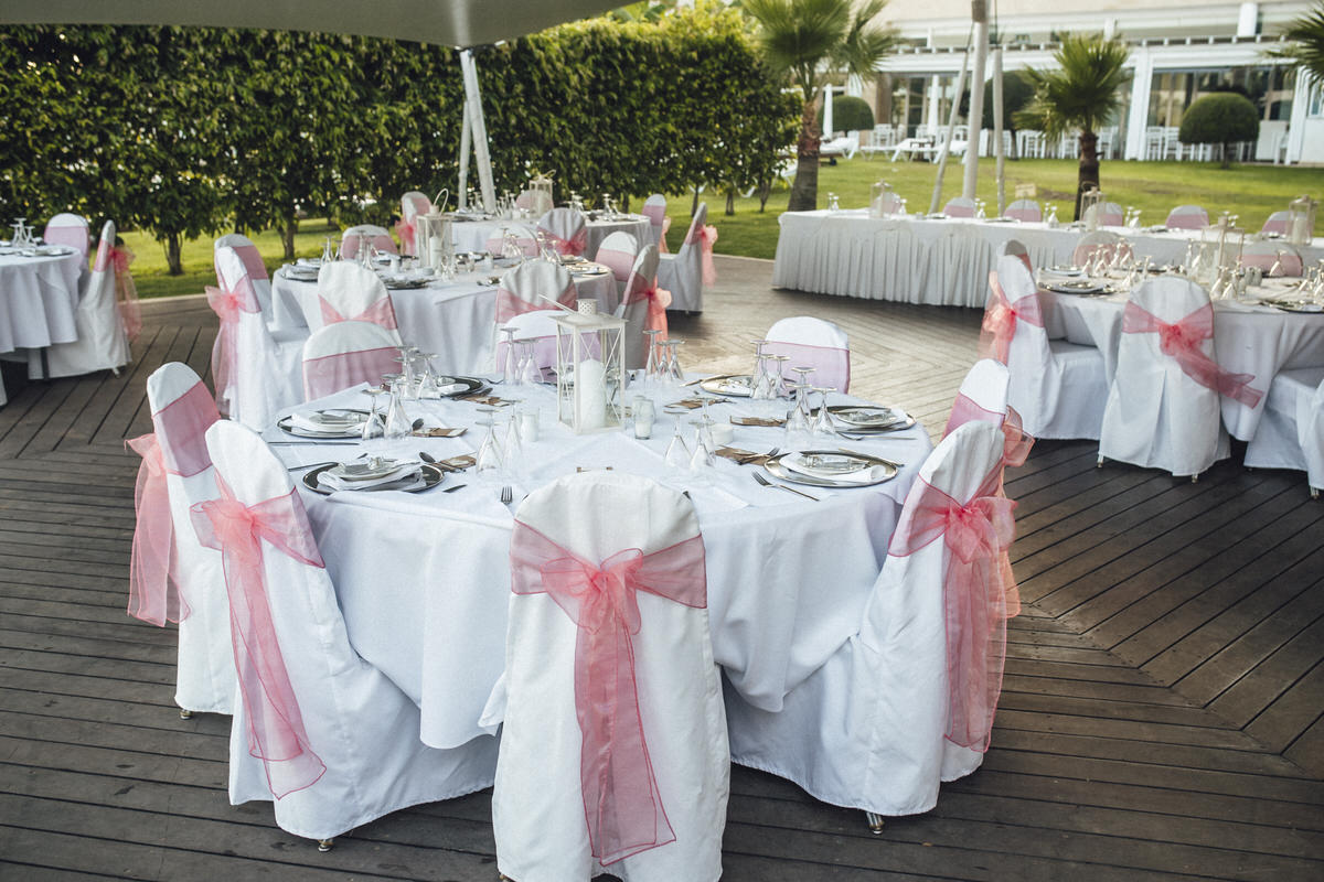 coral chair sashes on white chairs