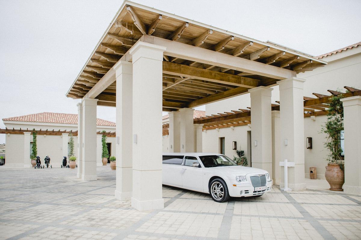 white limo outside venue