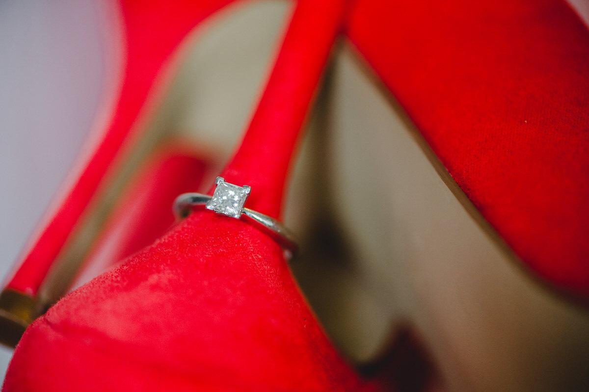 engagement ring on heel of wedding shoe