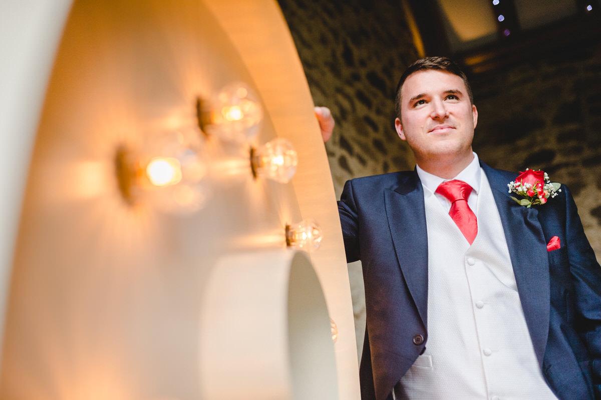 Groom posing before his bride arrives
