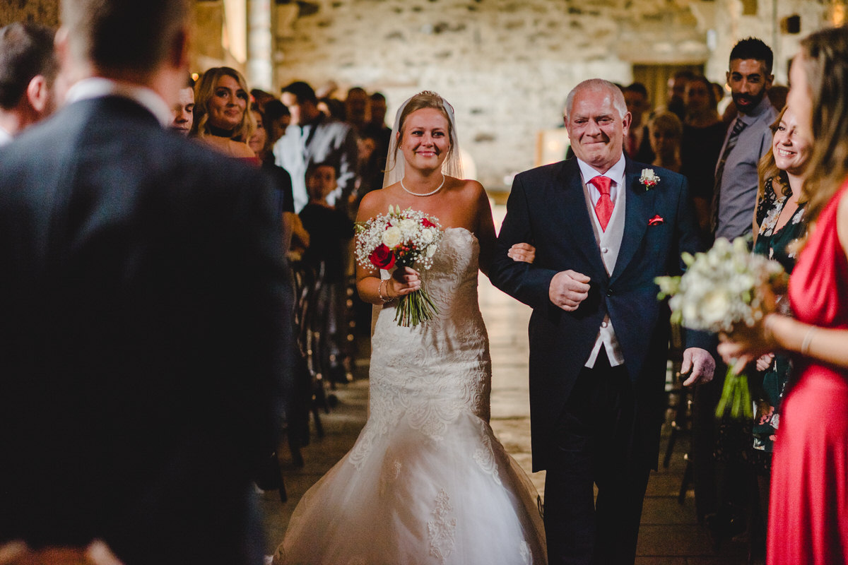 Father proudly walks his daughter down aisle