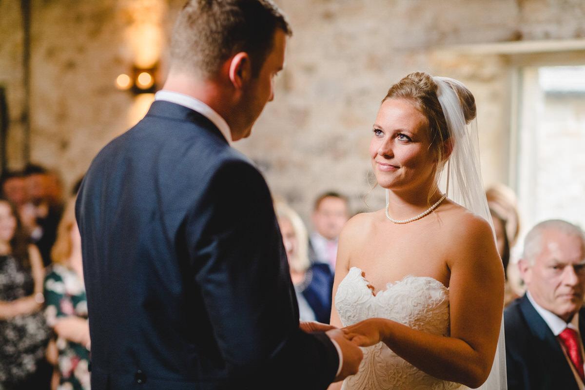 Adoring bride looks at her husband