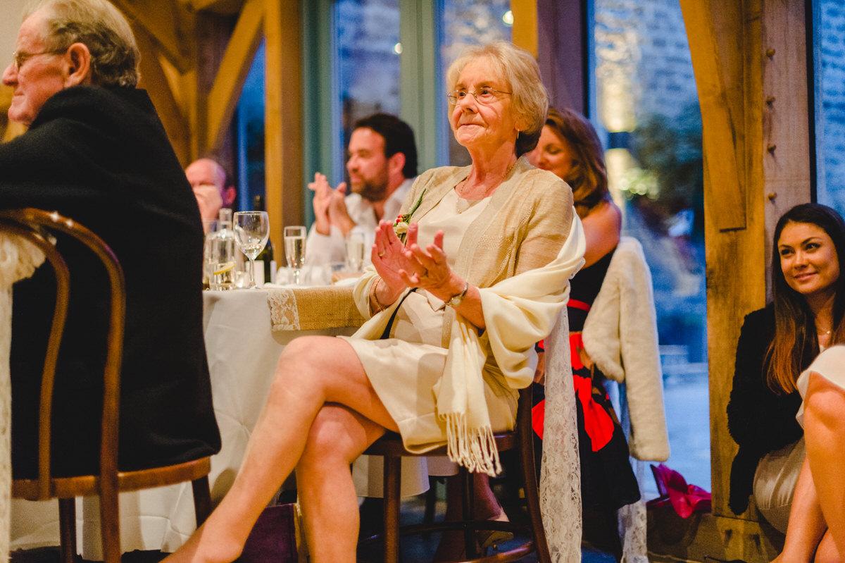 grandmother applauds her grandson