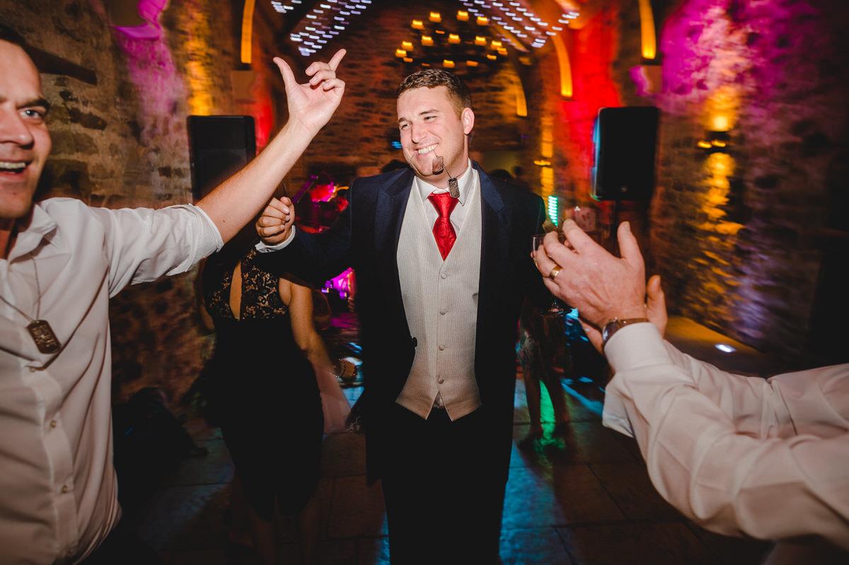 Happy groom dancing party