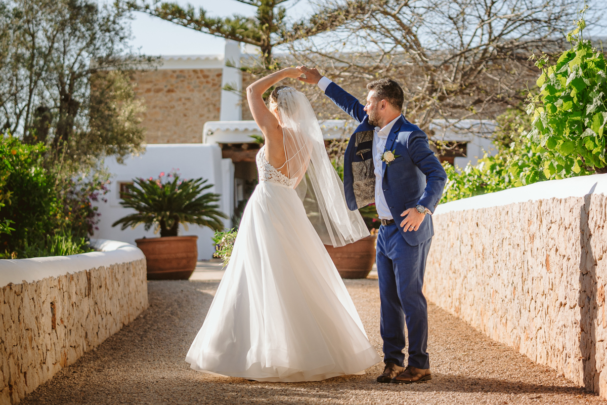 Can Gall Ibiza wedding photographer captures wedding couple twirling on the terrace